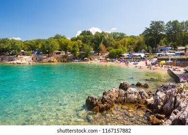Malinska, Croatia - 13.8.2018:  Beautiful beach near Malinska on island Krk in Croatia. Camping on island Krk in Croatia.