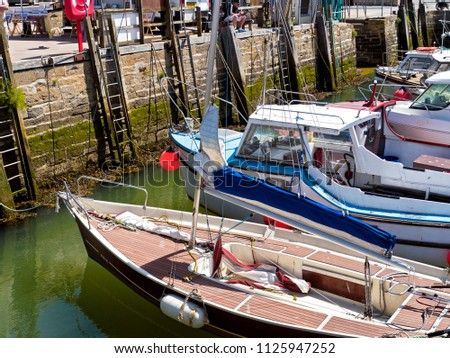 mall boats moored in harbor, Weymouth, Dorset, June 2018