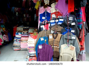 The Mall, Darjeeling - 31 May 2019: Colourful woolen garments like sweater, shawl, cardigans on sale in the market in the Mall of Darjeeling.