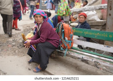 The MALL, Darjeeling, West Bengal/India: March 23, 2017: A Nepali woman in the traditional dress resting in the mall of Darjeeling before going to office