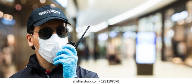 Mall Or Retail Store Security Guard Officer In Face Mask