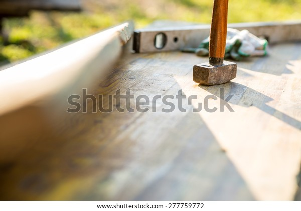 Mallet Builders Level On Outdoor Patio Royalty Free Stock Image