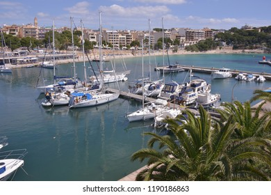 Mallorca, Baleares, Spain - may 31, 2013: Landscape with palm trees and pleasure boats in the marina of Manacor, a sunny day