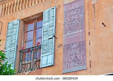 Mallorca, Balearic Islands: balcony and a signboard of a restaurant in the streets of Arta on June 6, 2012. Arta lies in the northeast of the island, around 35 miles from the island's capital of Palma