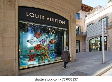 MALLORCA, BALEARIC ISLANDS, SPAIN - NOVEMBER 8 2017: Urban views Louis Vuitton store dressed for holidays in Palma de Mallorca on a sunny day on November 8, 2017 in Mallorca, Balearic islands, Spain.