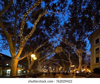 MALLORCA, BALEARIC ISLANDS, SPAIN - NOVEMBER 24 2017: Christmas holiday lights in Palma de Mallorca on a sunny day on November 24, 2017 in Mallorca, Balearic islands, Spain.