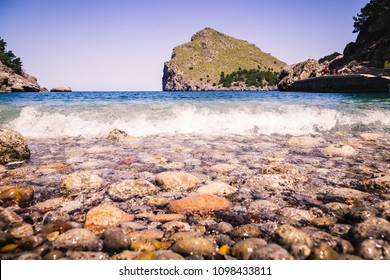 Mallorca beach stones and waves view in summer