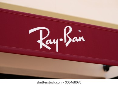 """MALLORCA - JULY 31, 2015: The Logo of the brand """"Ray Ban""""  in Festival Park Outlets in Mallorca"""