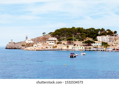 Mallorca panorama view with Mountains and green forest and blue sky and town on the coast and ship