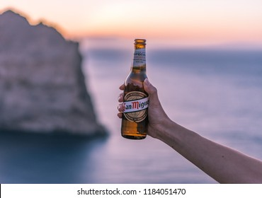 Mallorca, Spain - 19 September, 2017: San Miguel Beer and sunset.