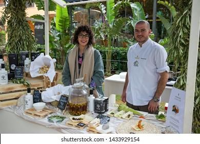 Mallorca, Spain - 26.05.2019: The sellers of olive oil at a County fair