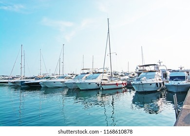 MALLORCA, SPAIN - AUGUST 30, 2018: Luxury yachts in Puerto Portals marina on a late summer sunny afternoon on August 30, 2018 in Mallorca, Spain