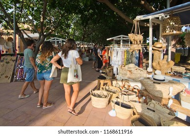 MALLORCA, SPAIN - AUGUST 30, 2018: Vendors and visitors at the Sunset Market in Puerto Portals on a late summer sunny afternoon on August 30, 2018 in Mallorca, Spain