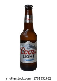 MALLORCA, SPAIN - JULY 22, 2020: Coors light beer, fresh bottle of American beer with mountain water.