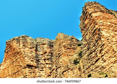 Mallos de Riglos y, Agüero, tourist destination, rock formations, erosion, geology, geological interest, murallones, ideal for mountaineers, Aragón, Spain,