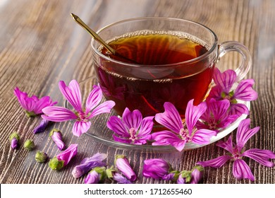 mallow herb and mallow flower tea in cup.
