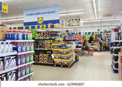 MALMEDY, BELGIUM - JULY 30, 2015: Interior of a Lidl supermarket. stacks of different products. Lidl is a German discount chain, 9800 stores, in 28 countries in Europe.