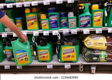 MALMEDY, BELGIUM - MAY 4, 2016: Shelves with a variety of Herbicides in a Carrefour Hypermarket. Roundup is a brand-name of an herbicide containing glyphosate, made by Monsanto.