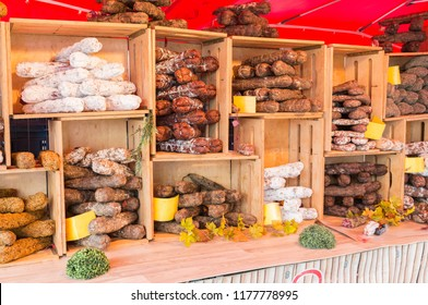 Malmedy,Belgium,15-august-2018: a market stall with various types of hard sausage, neatly displayed in wooden crates,the sausage are a specialty from belgian ardennes