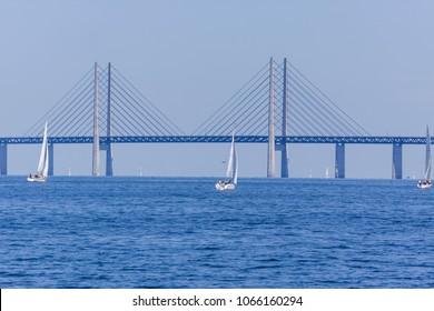 MALMO, SWEDEN - APRIL 10, 2018: Sailing in front of the Oresund bridge between Copenhagen Denmark and Malmo Sweden when spring