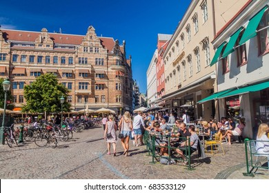 MALMO, SWEDEN - AUGUST 27, 2016: People enjoy a sunny day at Stortorget square in Malmo, Sweden.