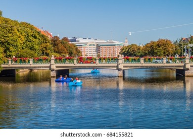 MALMO, SWEDEN - AUGUST 27, 2016: People enjoy a sunny day boating at Rorsjo canal in Malmo, Sweden.