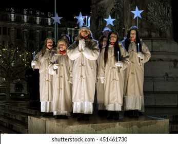 MALMO, SWEDEN - DECEMBER 13, 2015: Lucia and her entourage sing a song on the Main square during the celebration of St. Lucy's Day. Malmo's Lucia 2015 was elected Matilda Strom, a service dog handler.