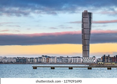 MALMO, SWEDEN - FEBRUARY 17, 2018: Turning Torso Building in West Harbour area in Malmo, Sweden. The tower is beside the Oredund bridge the new landmark of Malmo.