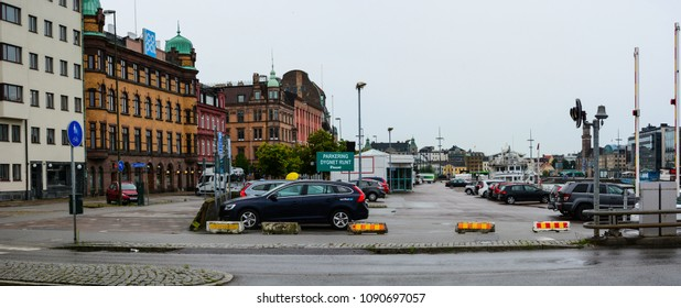 Malmo, Sweden - July 25, 2017: City parking, view from canal bridge in Malmö, Sound strait (Øresund), steel and glass building of Malmö University, canal waterfront