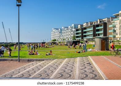 MALMO, SWEDEN - JUNE 05, 2011: People relaxing and sunbathe in the Western Harbour (Vastra Hamnen) district