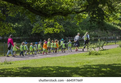 MALMO, SWEDEN - JUNE 12, 2017: A preschool class with their teachers are walking in the king´s park in Malmo, Sweden