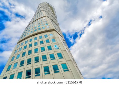 MALMO, SWEDEN - JUNE 25, 2015: Malmo Turning Torso, Distinctive Swedish City Landmark is designed by Spanish architect Santiago Calatrava and belongs to Neo-futuristic architectural style.