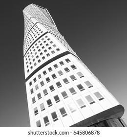 MALMO, SWEDEN - MARCH 8, 2011: Turning Torso skyscraper in Malmo, Sweden. Designed by Santiago Calatrava, it is the most recognized landmark of Malmo today.