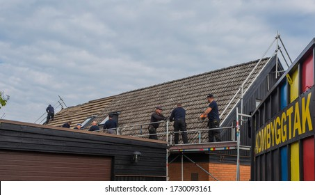 MALMO, SWEDEN - MAY 04, 2020: A team working with change the roof on a house