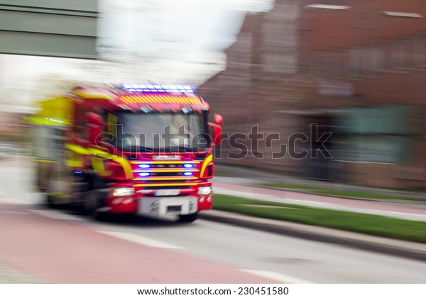 MALMO, SWEDEN - OCTOBER 26: Very fast driving red Scania fire truck in Malmo, Sweden on October 26, 2014.