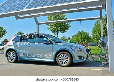 MALMO, SWEEDEN - MAY 25 - Electric car, part of the car-sharing system, standing at solar powered charge station (photovoltaics) on May 25, 2016 in Malmo, Sweden