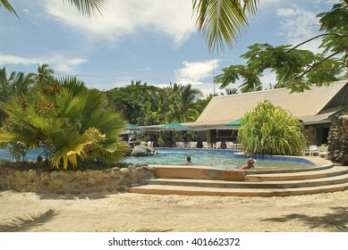 MALOLO LAILAI ISLAND, FIJI - MARCH 19: Unidentified people in swimming pool at Plantation Island Resort on the tiny island in South Sea, on March 19, 2005 in Malolo Lailai, Fiji
