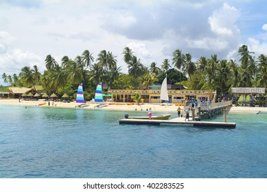 MALOLO LAILAI ISLAND, FIJI - MARCH 15: Unidentified people on jetty and sailing boats at Plantation Island resort in south sea, on March 15, 2005 in Malolo Lailai, Fiji