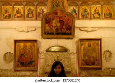 Maloua, Syria - July 07, 2010 : An orthodox christian Aramean woman is praying in Aramaic language in Malula city of Syria.
