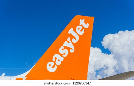 MALPENSA, ITALY JUNE 2018 Easyjet company logo on airplane rudder, British Low-Cost-Airline. Easyjet airplane on the track.