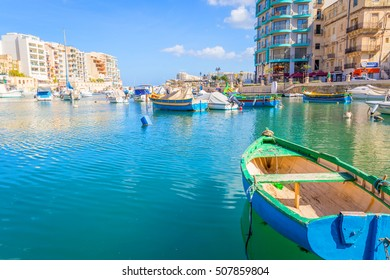 MALTA - 22 SEPTEMBER, 2016: Colorful Fishing Boats in Saint Julian Harbor, Malta
