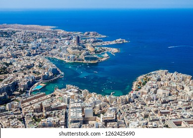 Malta aerial view. St. Julian's (San Giljan) and Tas-Sliema cities. St. Julian's bay, Balluta, Spinola bays. Portomaso Business Tower. Coastline of Malta from above. Skyscraper in Paceville district