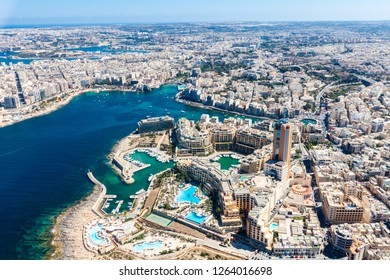 Malta aerial view. St. Julian's (San Giljan) and Tas-Sliema cities. St. Julian's bay, Portomaso Business Tower. Towns, harbours and coastline of Malta from above. Skyscraper in Paceville district.