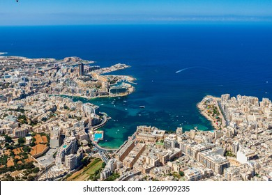 Malta aerial view. St. Julian's (San Giljan) and Tas-Sliema cities. St. Julian's bay, Balluta bay, Spinola bay, Towns, harbours and coastline of Malta from above. Skyscraper in Paceville district.