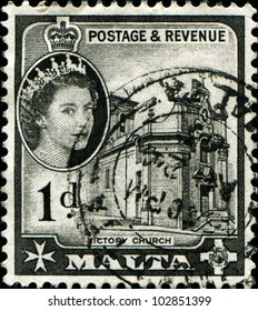 MALTA - CIRCA 1956: A stamp printed in Malta shows Queen Elizabeth II and Victory Church, circa 1956