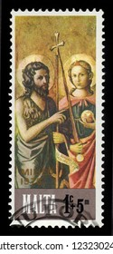 Malta - CIRCA 1976: A stamp printed in Malta shows St. John the Baptist and St. Michael, bible scene, painting by italian painter of the florentine school Domenico di Michelino, series Christmas, circ