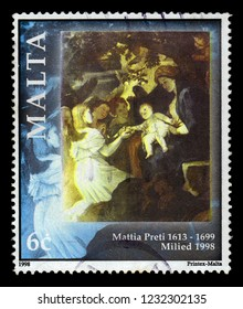 Malta - CIRCA 1998: A stamp printed in Malta shows rest on the way to Egypt, bible scene, painting by italian painter Mattia Preti, series Christmas, circa 1998
