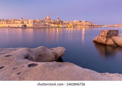 Malta. The coastline along Valletta and the harbor at sunrise.