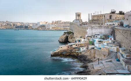 Malta. The Grand Harbour view with Valletta seafront, Siege Bell memorial and Lower Barrakka Gardens. City of Valletta, Malta