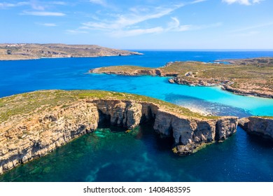 Malta landscape. Comino island coastline from above. Aerial view. Blue lagoon and sea caves of Comino island. Summer sea background. Travel destination in Europe Malta islands.
